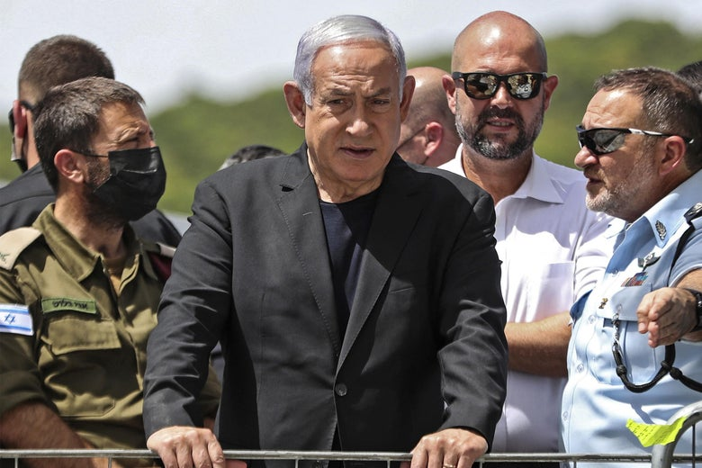 Israeli Prime Minister Benjamin Netanyahu visits the site of an overnight stampede during an ultra-Orthodox religious gathering in the northern Israeli town of Meron, on April 30, 2021. - The massive stampede at the densely-packed site near the reputed tomb of Rabbi Shimon Bar Yochai, a second-century Talmudic sage, where mainly ultra-Orthodox Jews flock to mark the Lag BaOmer holiday, killed at least 44 people in northern Israel, blackening the country's largest COVID-era gathering. (Photo by Ronen ZVULUN / POOL / AFP) (Photo by RONEN ZVULUN/POOL/AFP via Getty Images)