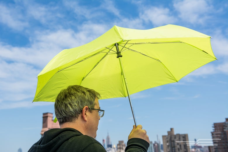 man holding a green umbrella