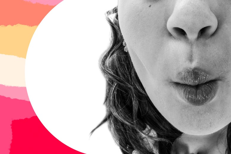 A close-up of a child's puckered lips, preparing for a smooch