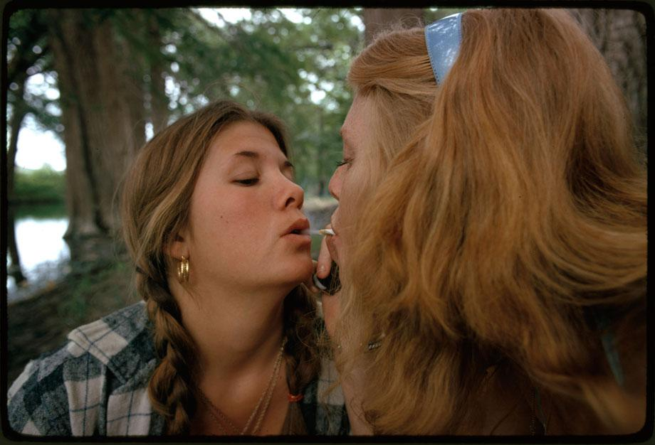 "Two girls smoking pot during an outing in cedar woods near Leaky, Texas (taken with permission), one of nine pictures near San Antonio,"" May 1973Photographer: M. St. GilSeries: Photographs and other Graphic Materials from the Environmental Protection Agency, (12/09/1970-)Record Group 412: Records of the Environmental Protection Agency, 1944-2006ARC Series Identifier: 554907Still Pictures Identifier: 412-DA-12455Rediscovery Identifier: 25282"