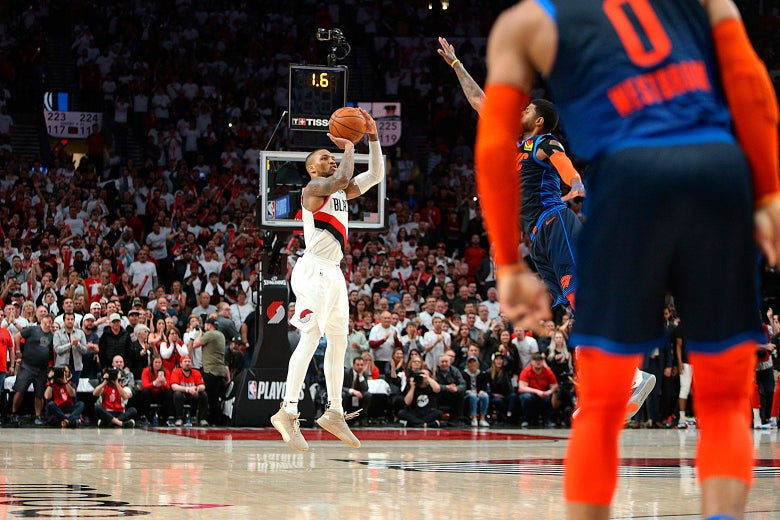 Damian Lillard shoots the game-winning three-pointer to beat the Oklahoma City Thunder 118-115 in Game 5 of the first round of the NBA Playoffs on April 23, 2019.