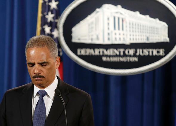 Attorney General Eric Holder holds a news conference announcing updates in the Justice Department's investigation of the shooting of Michael Brown in Washington, D.C., on Sept. 4, 2014
