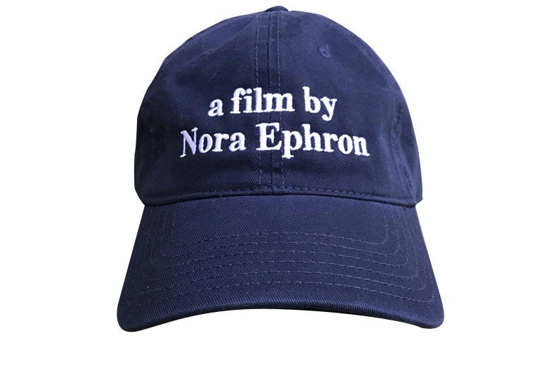 "Baseball cap that reads ""a film by Nora Ephron."""