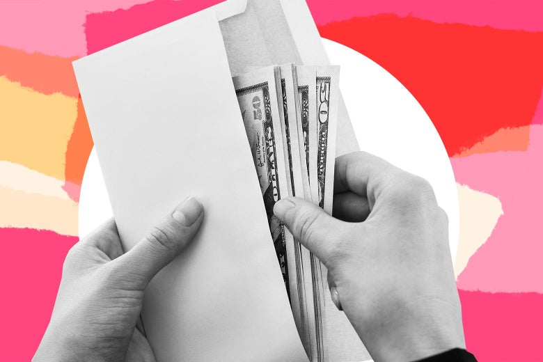 A hand reaches into an envelope full of cash.