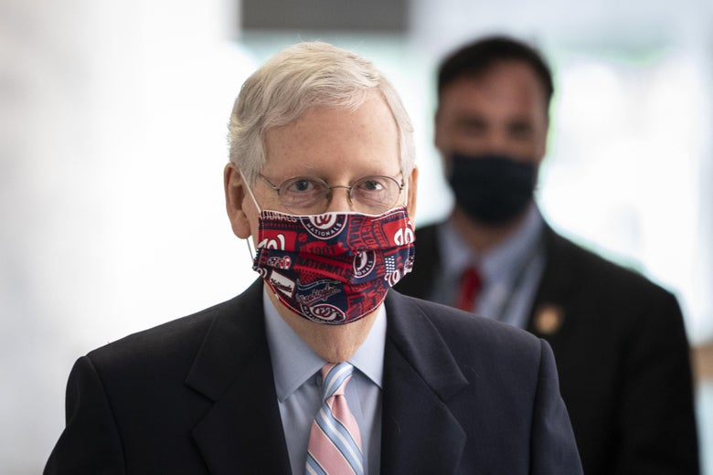 Mitch McConnell wearing a Washington Nationals mask.