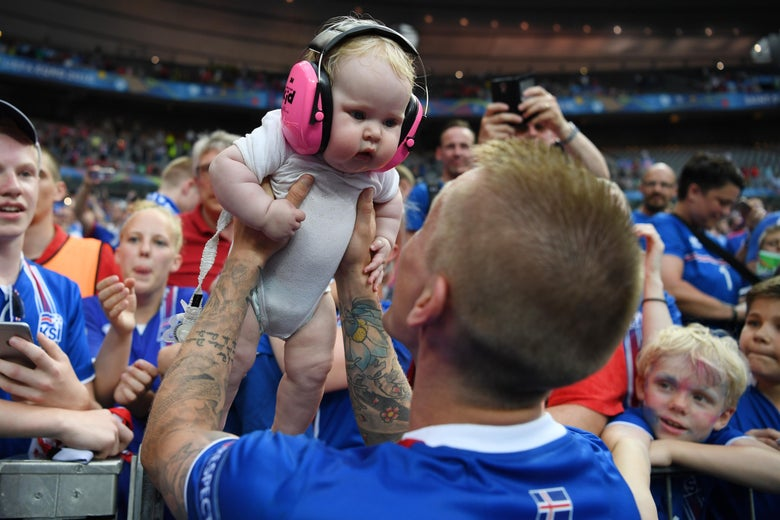 PARIS, FRANCE - JUNE 22:  Ari Skulason of Iceland celebrates his team's 2-1 win with his child after the UEFA EURO 2016 Group F match between Iceland and Austria at Stade de France on June 22, 2016 in Paris, France.  (Photo by Shaun Botterill/Getty Images)