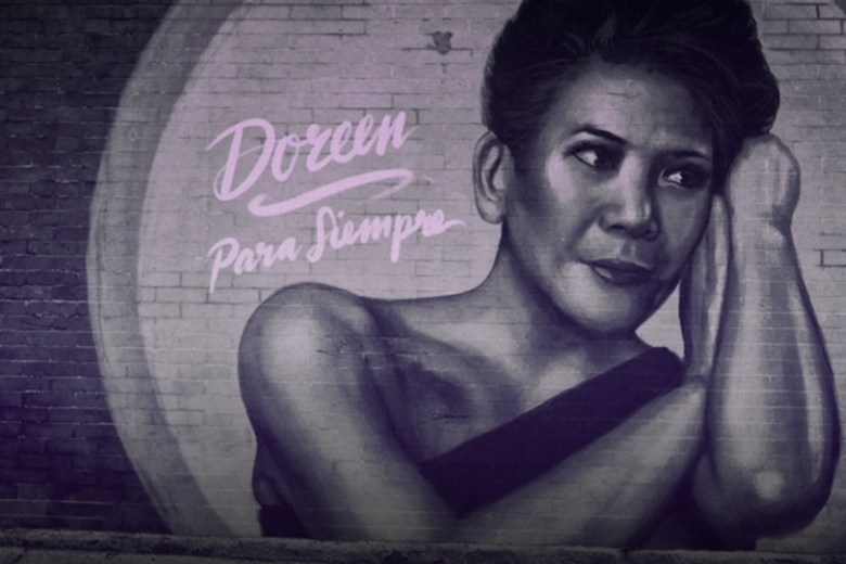 """A graffiti painting on a brick wall showing a woman says """"Doreen"""" and below that """"Para Siempre."""""""