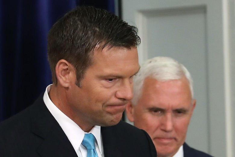 WASHINGTON, DC - JULY 19: Kansas Secretary of State, Kris Kobach (L) and US Vice President Mike Pence, attend the first meeting of the Presidential Advisory Commission on Election Integrity in the Eisenhower Executive Office Building, on July 19, 2017 in Washington, DC.  (Photo by Mark Wilson/Getty Images)