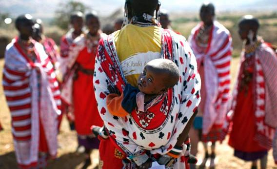 A Maasai woman carries her baby as she sings traditional songs during Emayian o nkituaak (blessing of women), a rare fertility ceremony in Kisokon village, southwest Nairobi September 28, 2008.