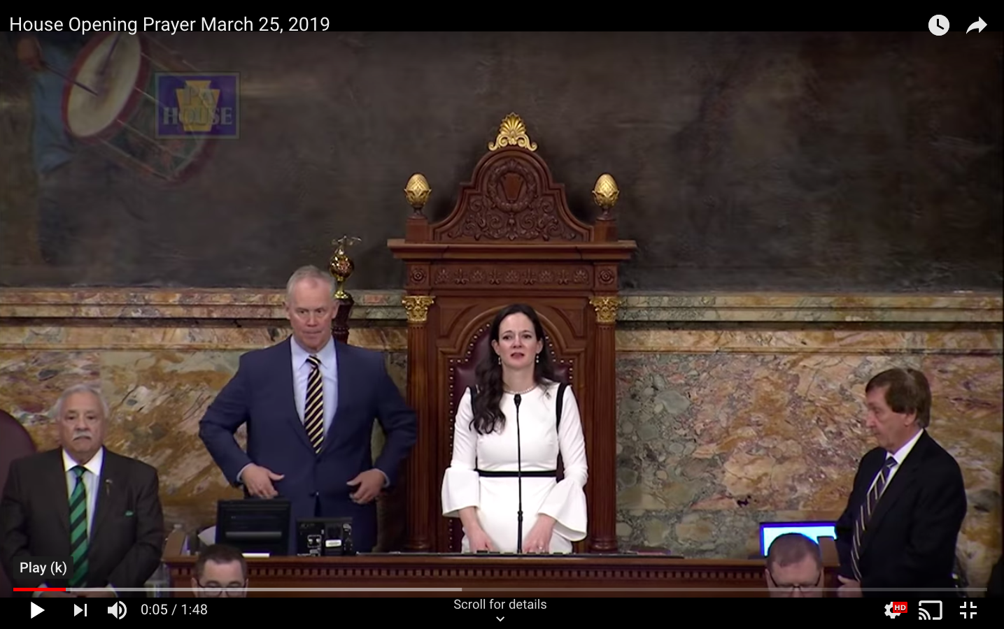 A still from the video of the prayer at the Statehouse.