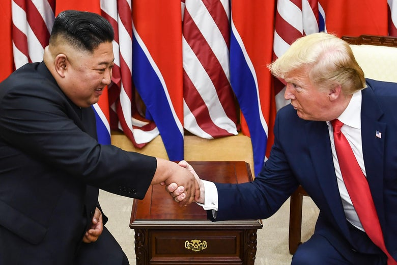 North Korea's leader Kim Jong Un and President Donald Trump shake hands during a meeting on the south side of the Military Demarcation Line that divides North and South Korea, in the Joint Security Area (JSA) of Panmunjom in the Demilitarized zone (DMZ) on June 30, 2019.