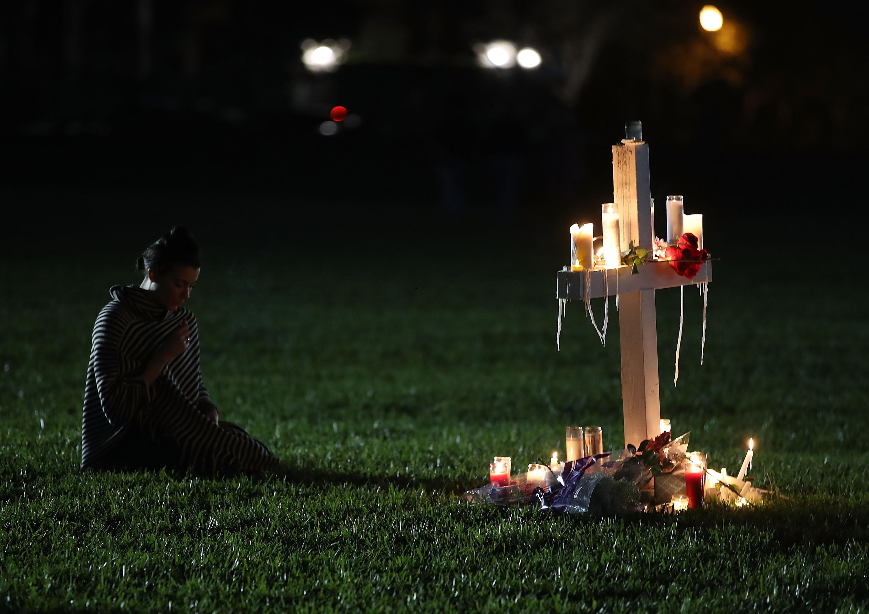 A former Douglas student during a vigil for victims of the mass shooting at Marjory Stoneman Douglas High School at Pine Trail Park, on February 15, 2018 in Parkland, Florida.
