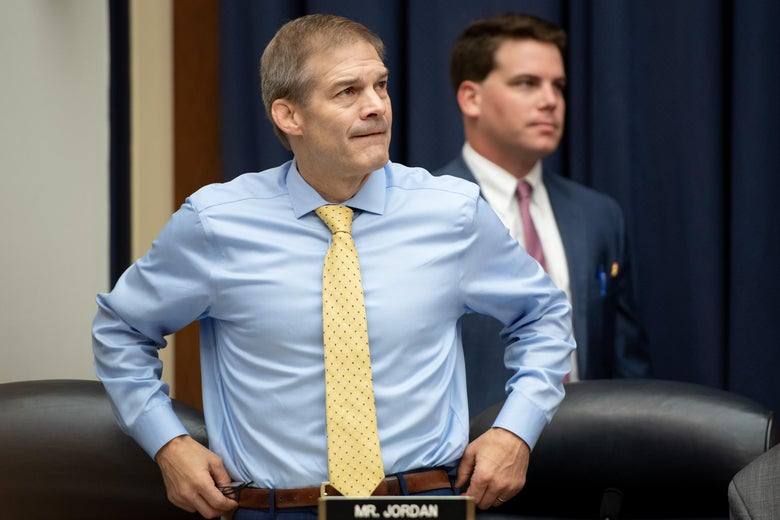 Jim Jordan standing in a hearing room.