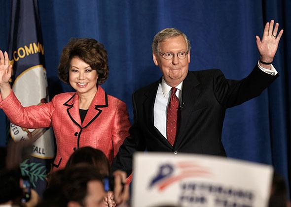 Mitch McConnell (R-KY) and his wife Elaine Chao arrive for a victory celebration following the early results of the state Republican primary.