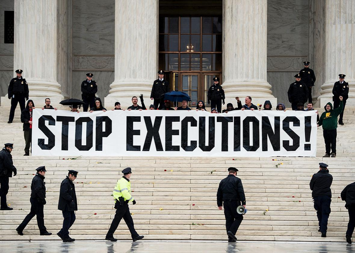 Police officers gather to remove activists during an anti death penalty protest in front of the US Supreme Court January 17, 2017 in Washington, DC.