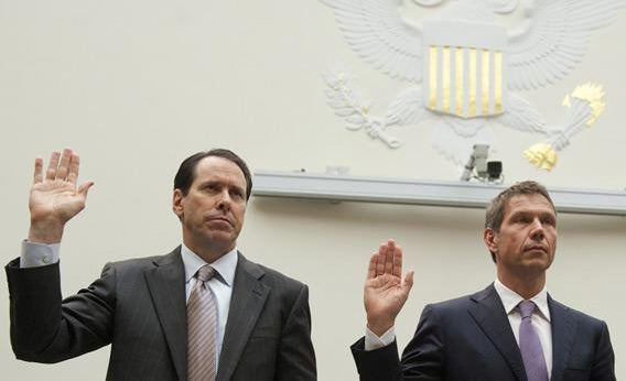 AT&T CEO Randall Stephenson (left) and Deutsche Telekom CEO Rene Obermann are sworn in before a House hearing on the proposed merger of the telecom giants