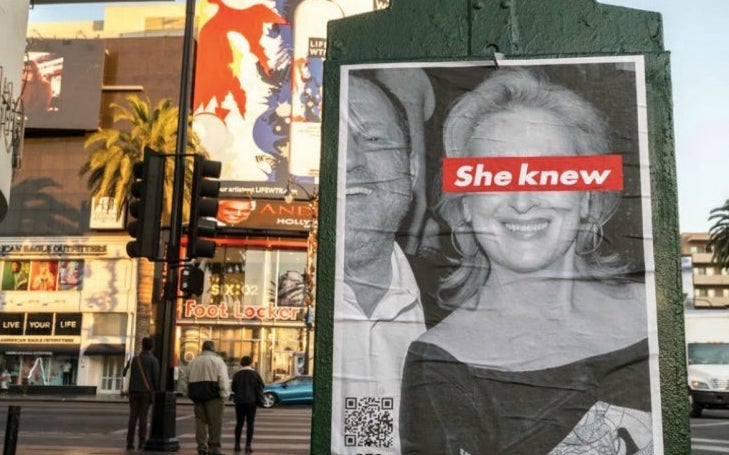 "The poster shows a black and white photograph of a smiling Streep beside a laughing Weinstein, declare that ""she knew"" via a red-and-white strip over her eyes (a reference to the work of artist Barbara Kruger)."
