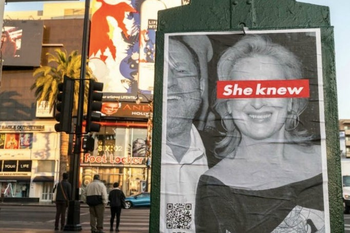 """The poster shows a black and white photograph of a smiling Streep beside a laughing Weinstein, declare that """"she knew"""" via a red-and-white strip over her eyes (a reference to the work of artist Barbara Kruger)."""