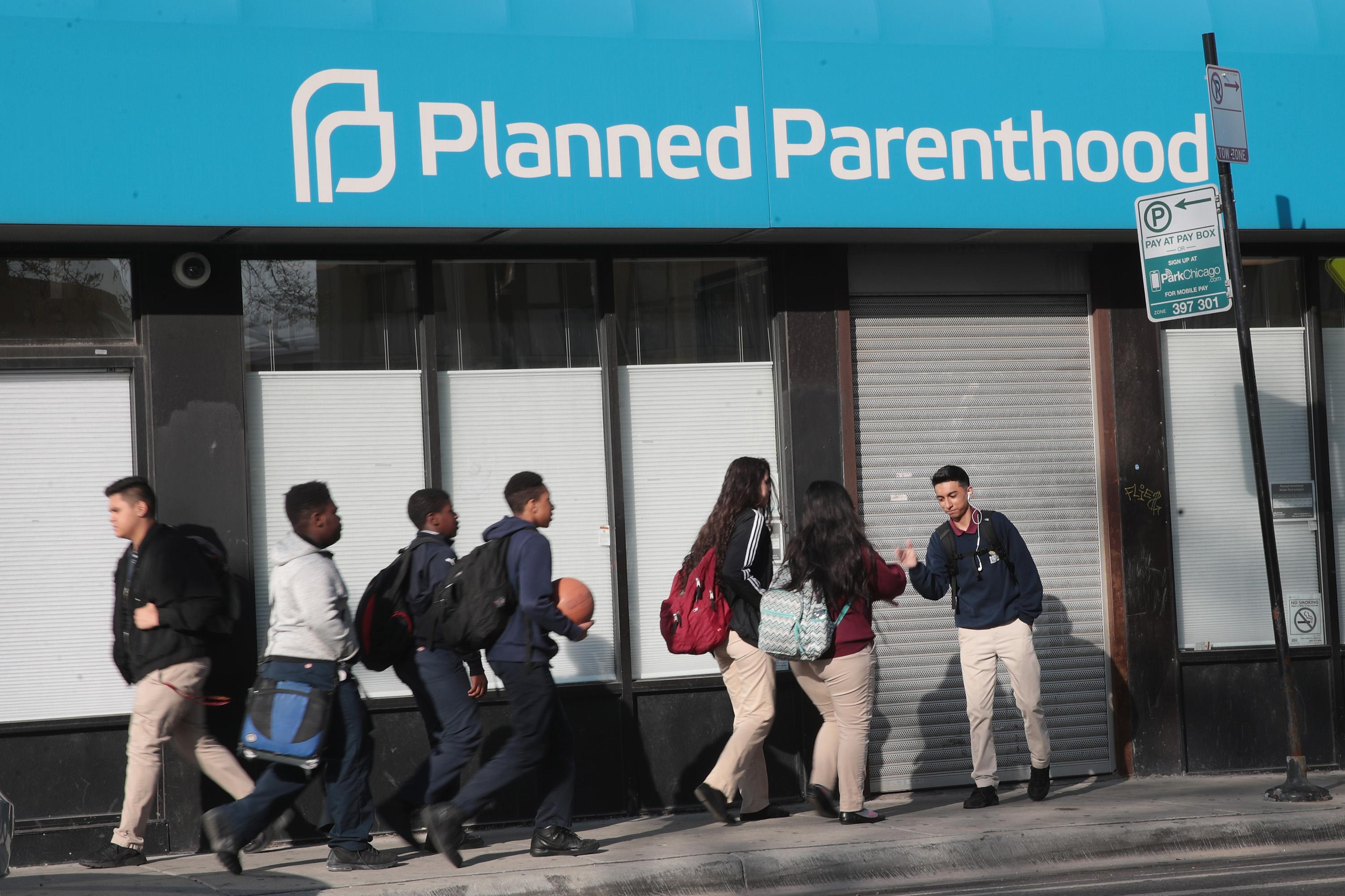 CHICAGO, IL - MAY 18:  Pedestrians walk past a Planned Parenthood clinic on May 18, 2018 in Chicago, Illinois. The Trump administration is expected to announce a plan for massive funding cuts to Planned Parenthood and other taxpayer-backed abortion providers by reinstating a Reagan-era rule that prohibits federal funding from going to clinics that discuss abortion with women or that share space with abortion providers.  (Photo by Scott Olson/Getty Images)