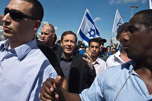 Isaac Herzog (C), co-leader of the centre-left Zionist Union.