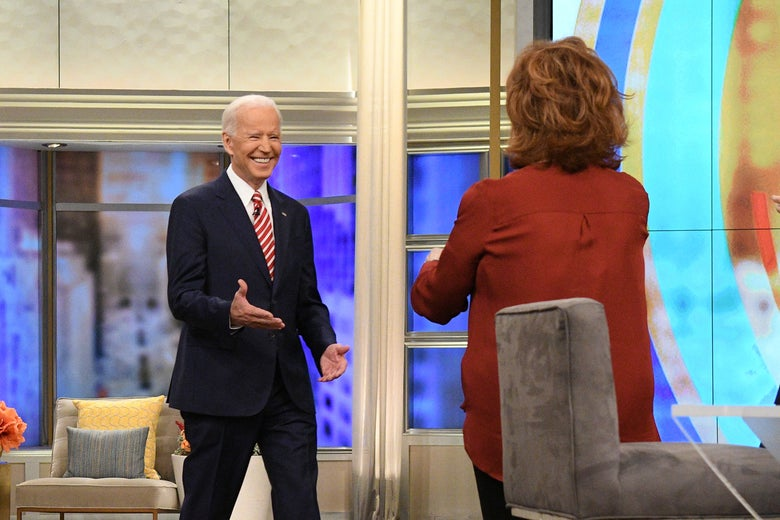Joe Biden is greeted by Joy Behar as he walks on set on ABC's The View.