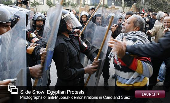 Egyptian Protests: Photographs of anti-Mubarak demonstrations in Cairo and Suez