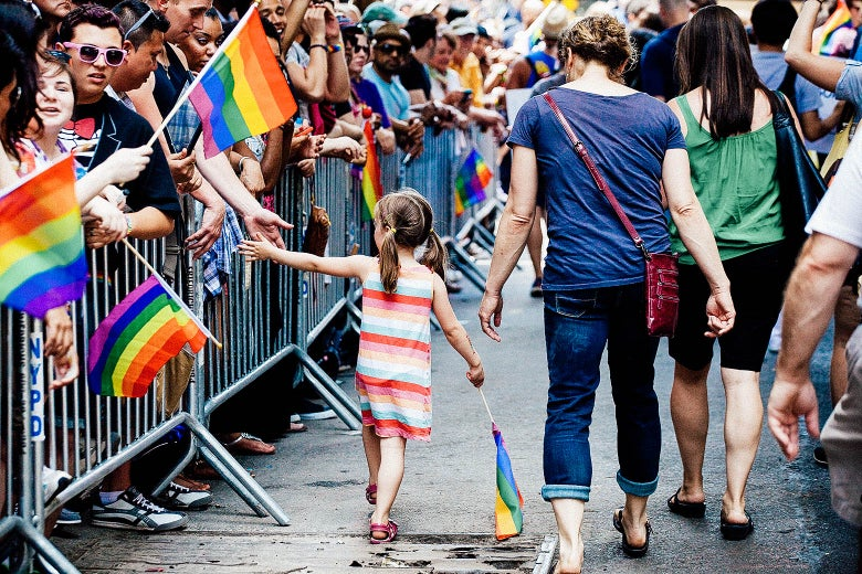 A girl high-fives a reveler as she participates in the NYC Pride March.