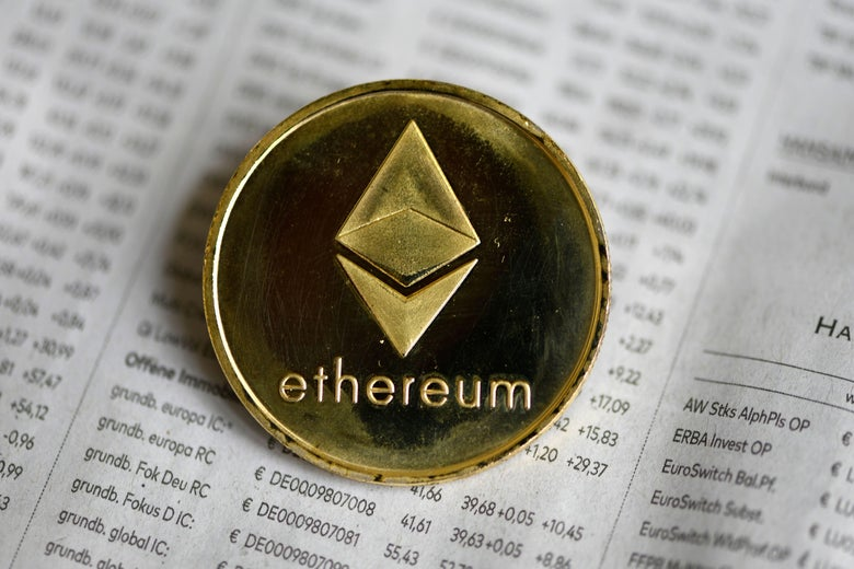 The photo shows a physical imitation of a Ethereum cryptocurrency token.