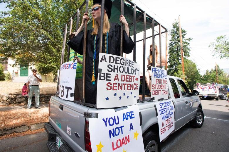 A demonstrator protests over student debt.