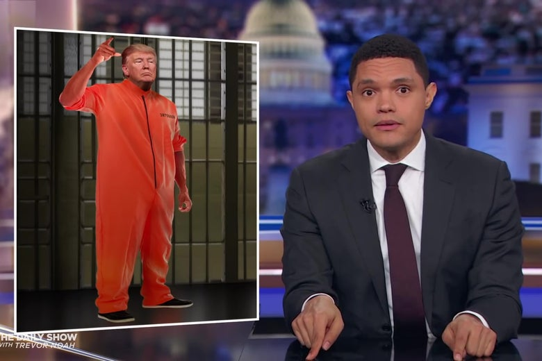 Trevor Noah in front of a Photoshopped image of Trump in a prison jumpsuit.