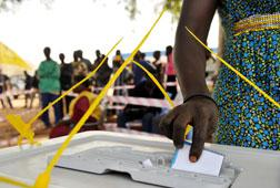 A Southern Sudanese woman casts her vote at a polling station in Rumbek. Click image to expand.