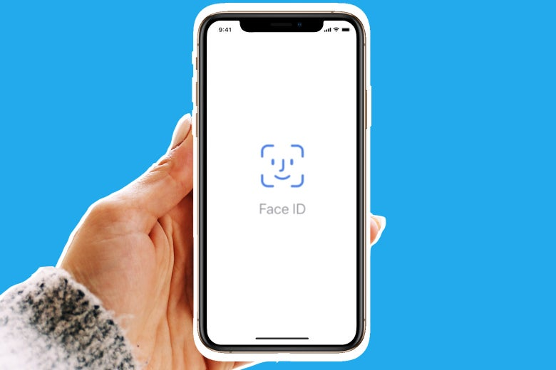Woman holding a iPhone XS, using Face ID.