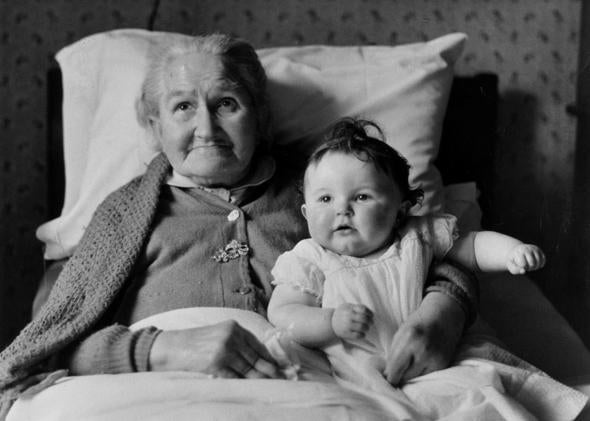 Eighty three year old Margaret Roberts with her eight month old great-great-granddaughter, February 1959.