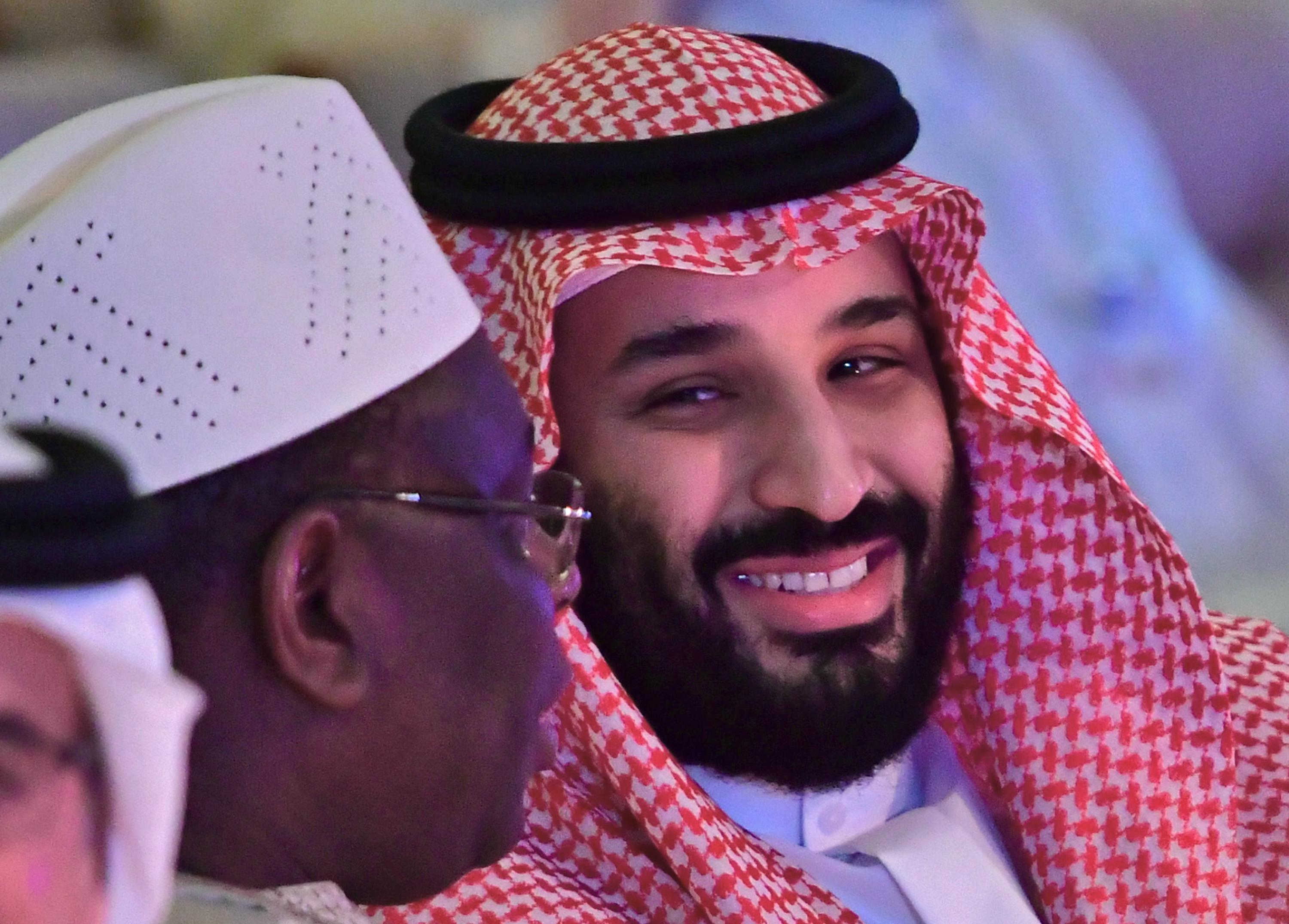 Saudi Crown Prince Mohammed bin Salman talks with the president of Senegal.
