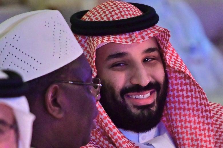 Saudi Crown Prince Mohammed bin Salman talks with the president of Senegal.