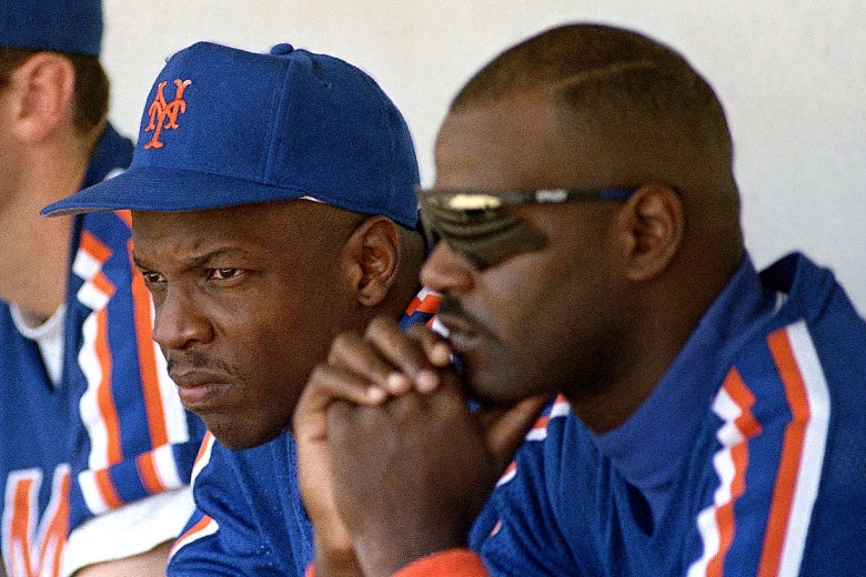 Dwight Gooden and Daryl Boston watch the game against the Atlanta Braves.
