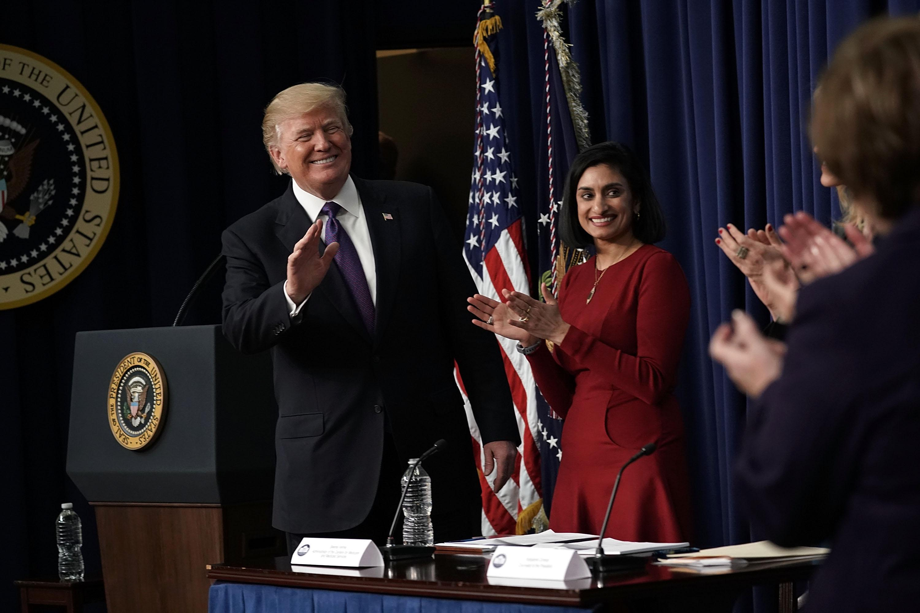 WASHINGTON, DC - JANUARY 16:  U.S. President Donald Trump (L) acknowledges the audience as Administrator of the Centers for Medicare and Medicaid Services Seema Verma (2nd L) looks on as he stops by a Conversations with the Women of America panel at the South Court Auditorium of Eisenhower Executive Office Building January 18, 2018 in Washington, DC. The three-part panel features ÒAmerican women from various backgrounds and experiences who will speak with high-level women within the Trump Administration, about what has been accomplished to date to advance women at home, and in the workplace.Ó  (Photo by Alex Wong/Getty Images)