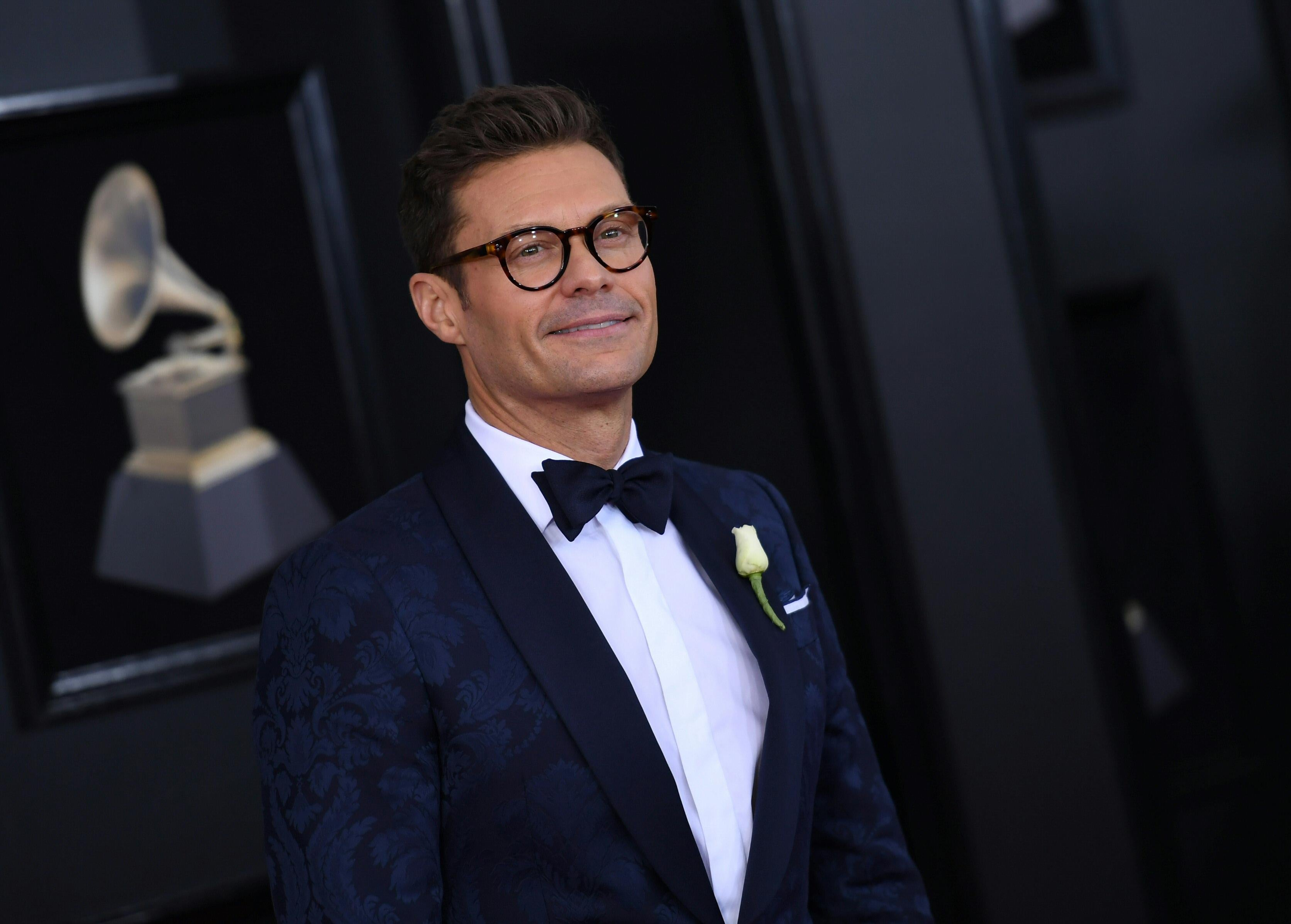 Ryan Seacrest arrives for the 60th Grammy Awards.