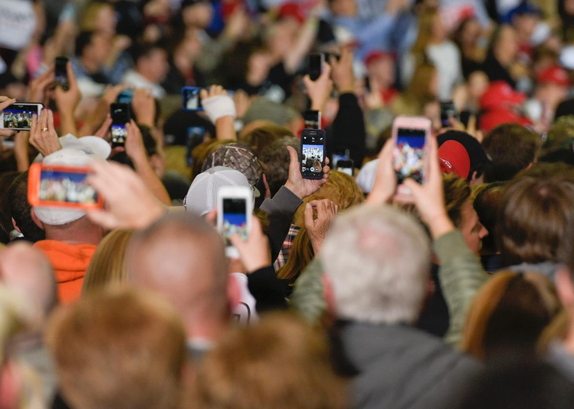 Supporters of Republican presidential nominee Donald Trump film him on their phones as he speaks during a rally at the Spire Institute in Geneva, Ohio on October 28, 2016.