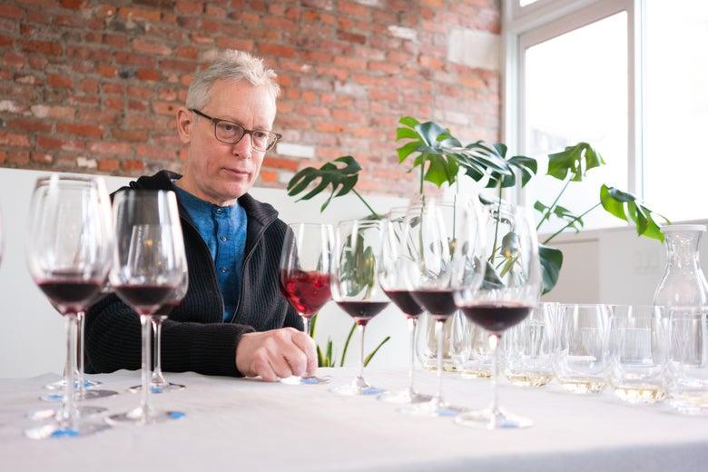 Eric Asimov swirls wine.