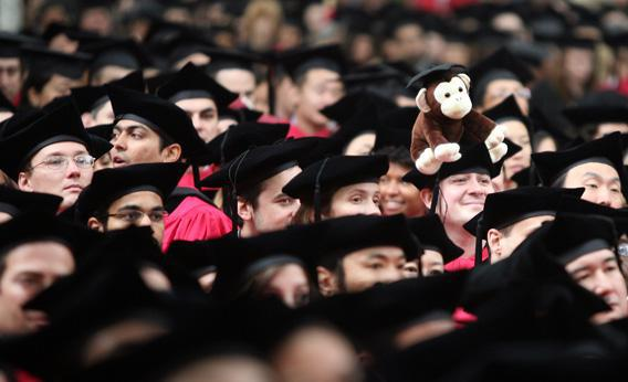A graduating student wears a stuffed monkey on his head during Harvard University's commencement ceremonies in 2008, in Cambridge, Massachusetts.