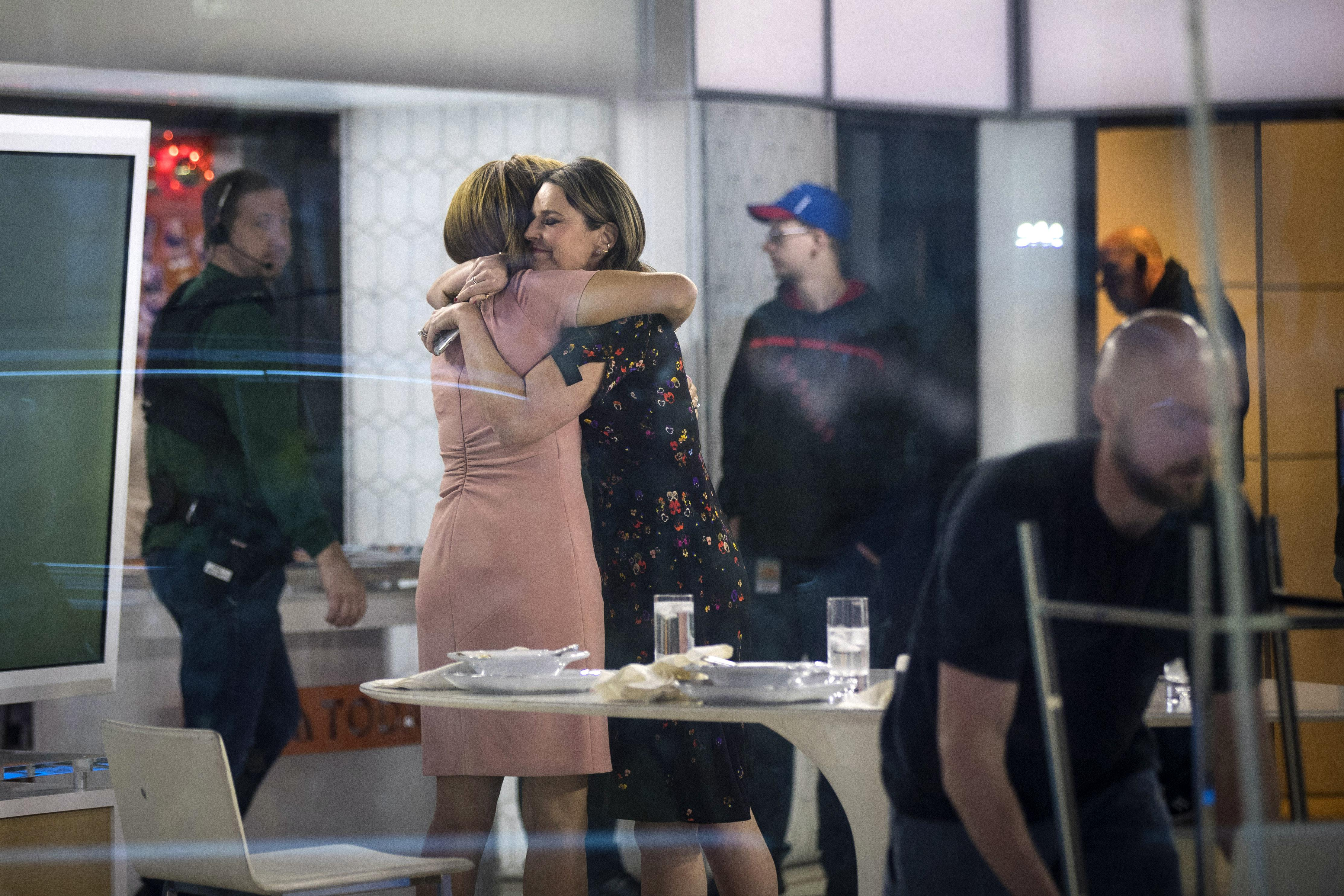 NEW YORK, NY - NOVEMBER 29: (L to R) Hoda Kotb and Savannah Guthrie embrace at the end of the show on the set of NBC's Today Show, November 29, 2017 in New York City. It was announced on Wednesday morning that long time Today Show host Matt Lauer had been fired for sexual misconduct. (Photo by Drew Angerer/Getty Images)
