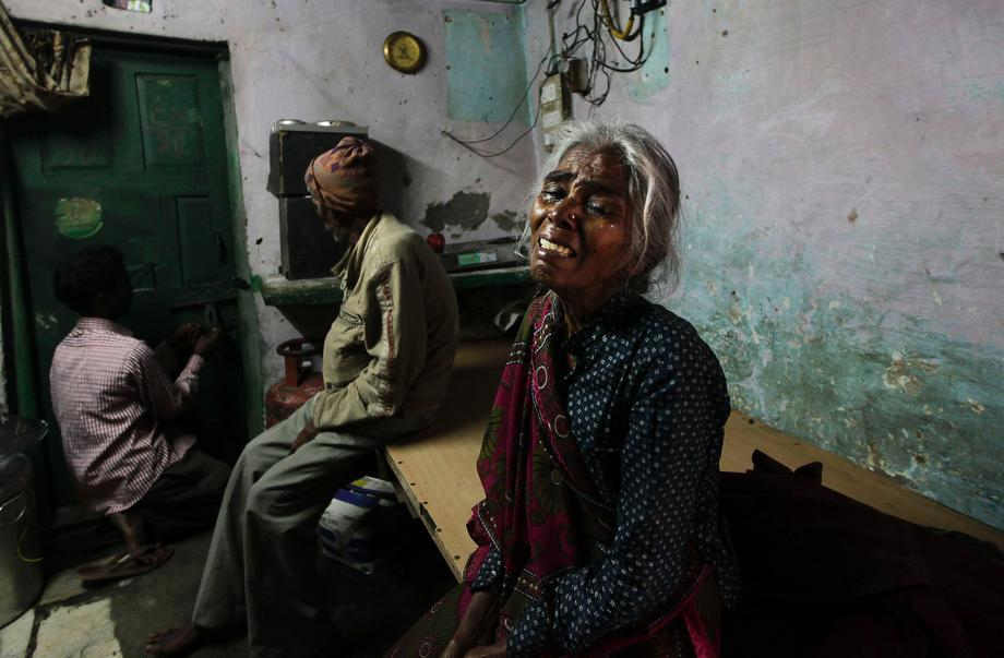 The mother of Ram Singh, the man accused of driving the bus on which a 23-year-old student was gang raped in December 2012, cries as she speaks to journalists inside the family's home in New Delhi, India, on March 11, 2013. Indian police confirmed that Ram Singh, one of the men on trial for his alleged involvement in the gang rape and fatal beating of a woman aboard a New Delhi bus, committed suicide in an Indian jail Monday, but his lawyer and family allege he was killed.