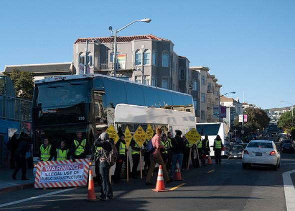 Protesters block a Google bus in San Francisco's Mission District in December.