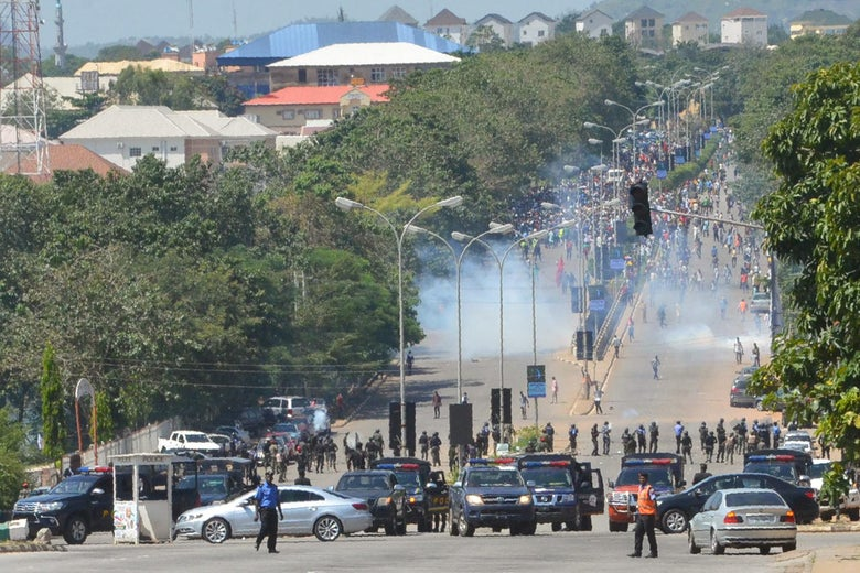 Police officers in Abuja firing teargas on protestors
