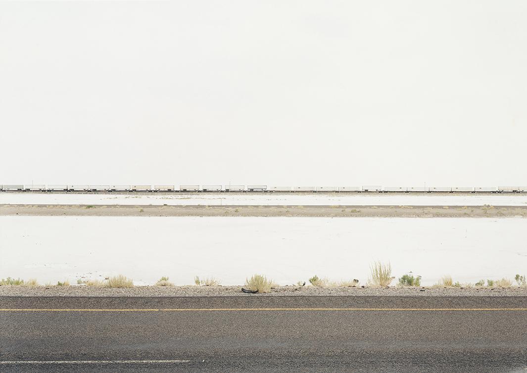 Untitled (White Trains on Salt Flats, I-80) Great Salt Lake Desert, Utah, 2002.