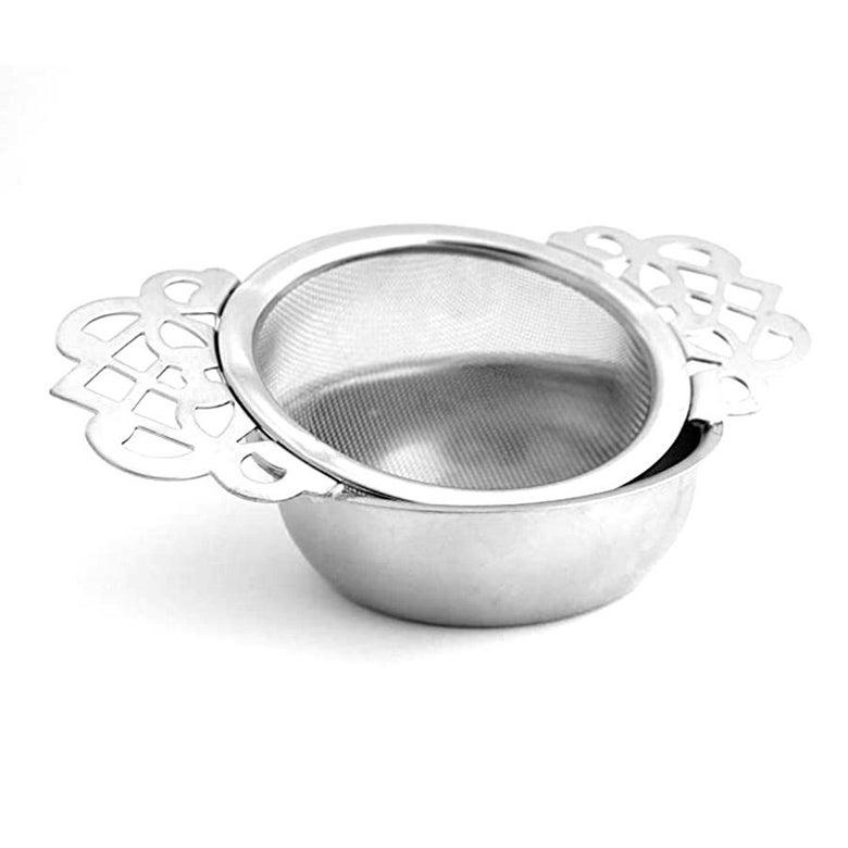 Metal tea strainer with metal lacework handles