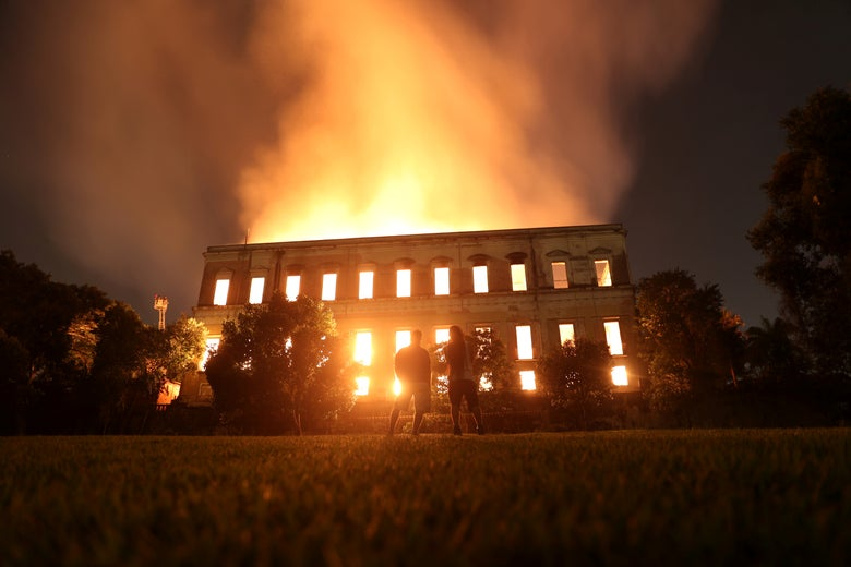People watch as a fire burns at the National Museum of Brazil in Rio de Janeiro, Brazil September 2, 2018.