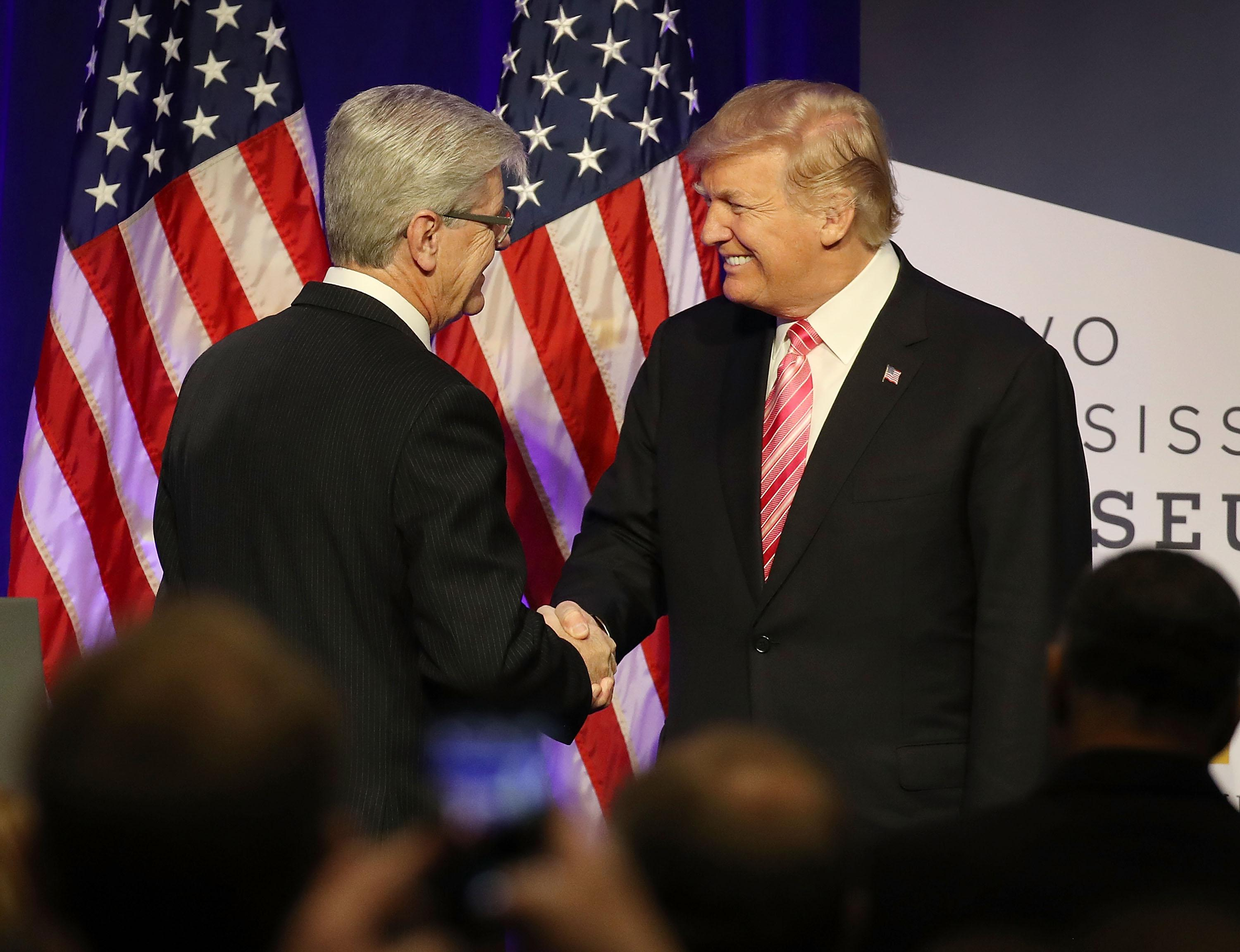 JACKSON, MS - DECEMBER 09:  President Donald Trump is introduced by  Mississippi Governor Phil Bryant to speak after touring the Mississippi Civil Rights Museum on December 9, 2017 in Jackson, Mississippi. The museum had a grand opening event with hopes to promote a greater understanding of the Mississippi Civil Rights Movement and its impact by highlighting the strength and sacrifices of its people.  (Photo by Joe Raedle/Getty Images)