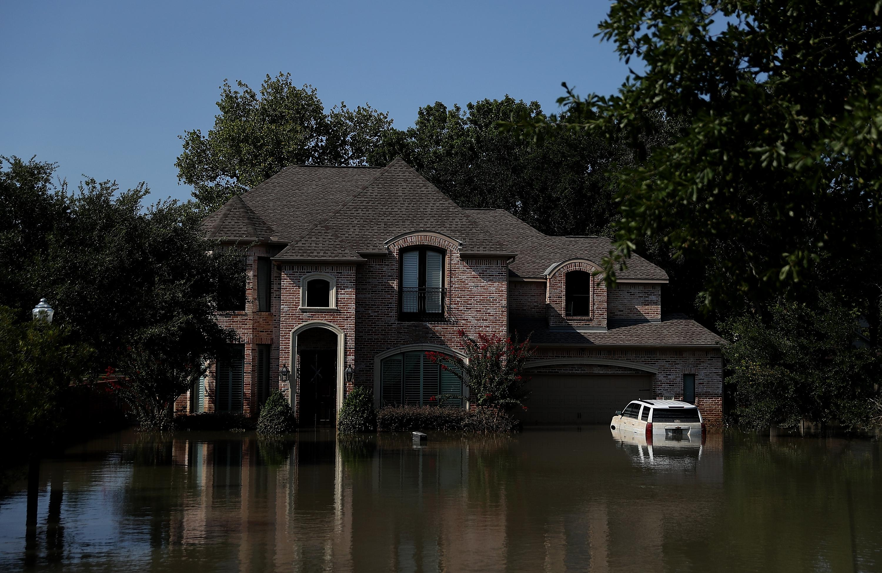 HOUSTON, TX - SEPTEMBER 06:  Floodwaters surround a home on September 6, 2017 in Houston, Texas. Over a week after Hurricane Harvey hit Southern Texas, residents are beginning the long process of recovering from the storm.  (Photo by Justin Sullivan/Getty Images)